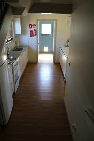 Looking from Stairs to kitchen and bathroom